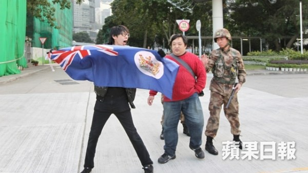Hong Kong demonstrators trespassed into PLA headquarters carrying British Colonial Hong Kong flags.