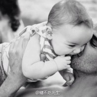 fathers-day-08-dad-holding-up-kissing-baby