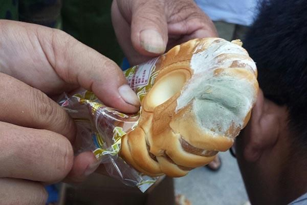 Moldy expired bread distributed to disaster victims as relief supplies in Hainan, China, after a typhoon.