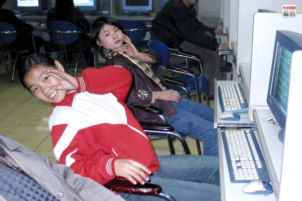 Young girls at an internet bar in China.