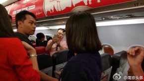 thai-airasia-flight-fd9101-turned-back-to-bangkok-unruly-chinese-couple-passengers-01