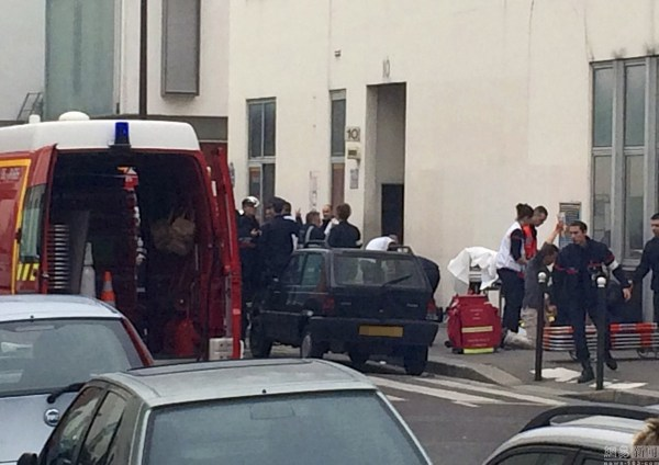 Photo is of the scene of the incident, where an injured person is being carried onto an ambulance.