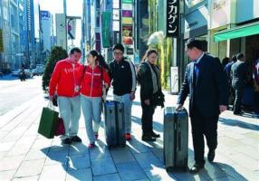 "Bringing a spirit of ""buy, buy, buy"" to Japan, Chinese tourists on Japanese are often accompanied with shopping bags of various sizes."