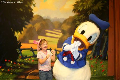 Sophie, age 6 in this photo, so excited to see Donald Duck!