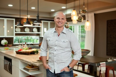 ATLANTA, GA: Licensed contractor Chip Wade in the newly renovated kitchen and living room of the Francis home in Atlanta, Ga. By knocking out walls in the existing kitchen and closing in the deck, the Francis family will now have a central space to share meals together and will also give the mother a better chance to watch the kids while she's in the kitchen, as seen on HGTV and DIY Network's Elbow Room. (portrait) (HGTV,DIY Network, Chip Wade,Elbow Room,Atlanta, home makeover, Francis, kitchen, addition, living room, deck, after)