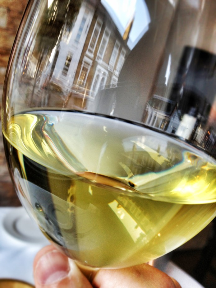 Chiswickish Food Blog - Reflection of Devonshire Road in wine glass at Quantus Restaurant