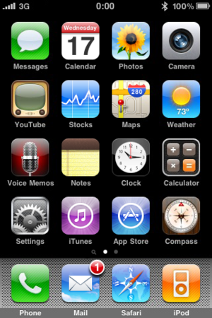 The default Home screen of the iPhone shows mo...