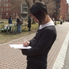 Tetsu Ohara, Coordinator of Green Week, fills out a survey