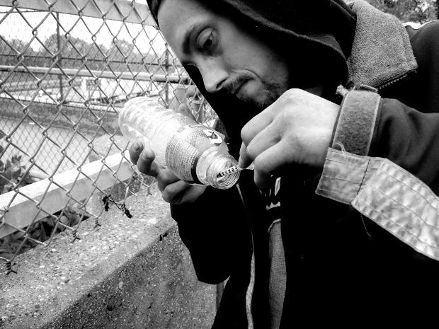 John Lee Draws Gatorade into his syringe.