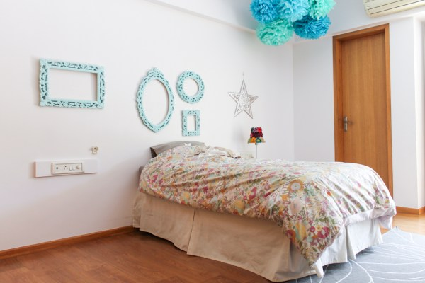 girls room with blue pompoms & frames-10