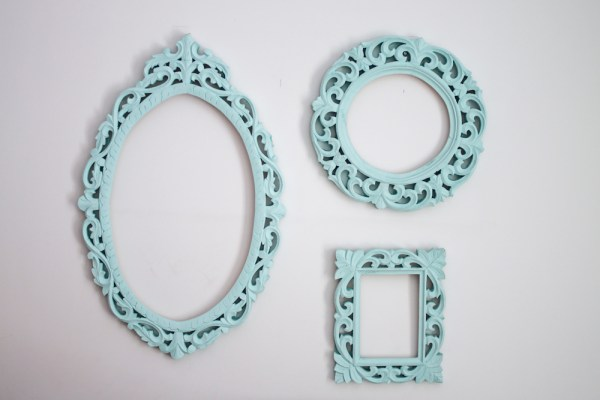 girls room with blue pompoms & frames-3