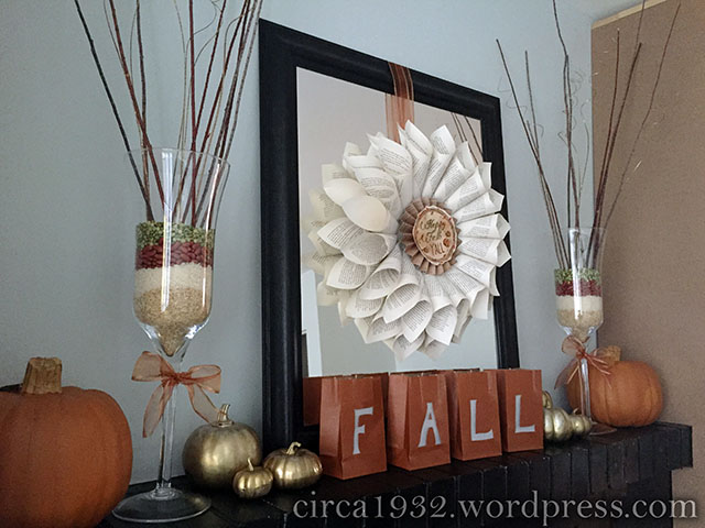 DIY fall mantle with gold pumpkins and bookcase wreath