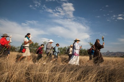Members of the Migrant Trail group journey through the desert in remembrance of immigrants who have lost their lives.