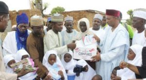Students-of-Shara-communitys-under-tree-school-receiving-sets-of-uniforms-and-learning-materials-donated-to-them-by-CITAD-Copy-300x167