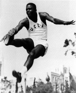 Robinson competing in the long jump for UCLA, 1945
