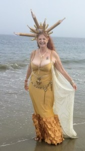 """SUZQ represents the golden line, the NW. She's a natural redhead, a 15-year Mermaid Parade participant, and has produced the Miss Black Rock City Pageant around the world! She's known for her fantastic costuming and head pieces. She'll teach us """"Stripper Lessons (for people who don't want to get naked)."""""""