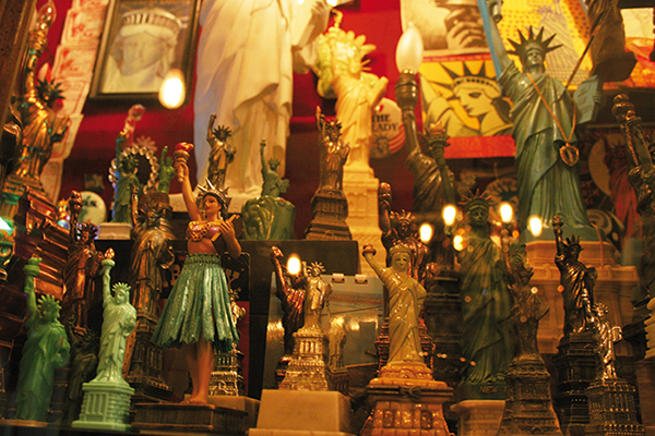 Many models of the Statue of Liberty in different sizes and materials on display at the City Reliquary