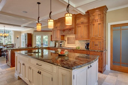 exotic kitchen design with marble countertop and fancy bulbs pendant lamps tiered ceiling and tile flooring lake house