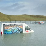 Flooded surf school vans at Lahinch promenade following the storm. Photograph by John Kelly.