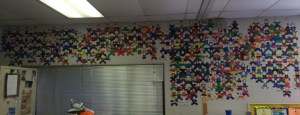 What roughly 400 students' puzzle people look like, all intertwined on the classroom wall