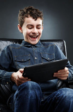 Child Playing on Ipad Tablet