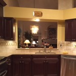 dark kitchen under lighting and appliances