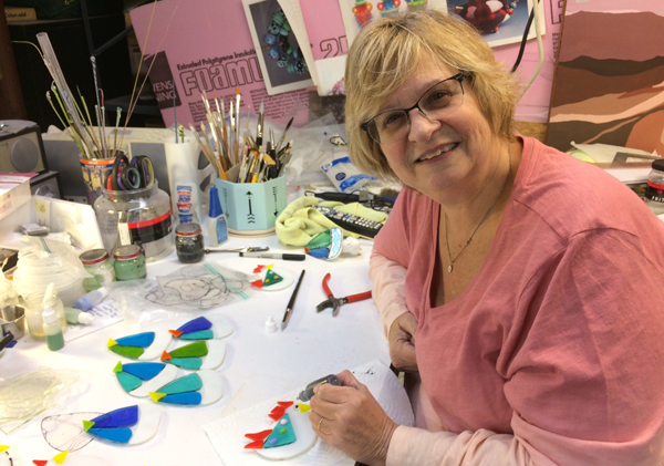 Debbie Harary at work in her studio. She's making night lights, ornaments and art glass for the holiday season.