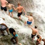 Tourists climbing Dunn's River Falls