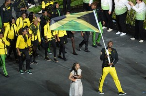 The Jamaican flag bearer Usain Bolt
