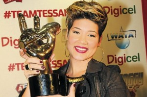 The Voice, Tessanne Chin, holds aloft the winner's trophy during a press conference at the Norman Manley International Airport following her return home on Friday. Read more: http://www.jamaicaobserver.com/news/Tessanna-says-thanks_15679960#ixzz2oCZCjrX2