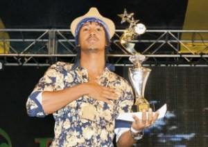 "Deep Jahi holds up his trophy for winning with ""I Love JA"""