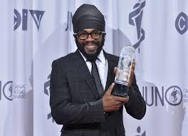 Exco Levi holding his Juno Award