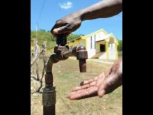 "RESIDENTS IN THE RED GROUND COMMUNITY COMPLAIN OF NOT GETTING WATER FOR SIX MONTHS, WHILE NEIGHBORING NEGRIL ""SWIMMING"" IN IT!"