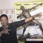 Oliivia Babsy Grange beside Usain Bolt's statue