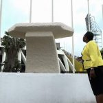 Minister of Culture, Gender, Entertainment and Sport, the Honourable Olivia Grange, looks at the pedestal on which the statue of Usain Bolt will be mounted on Statue Road in Independence Park.