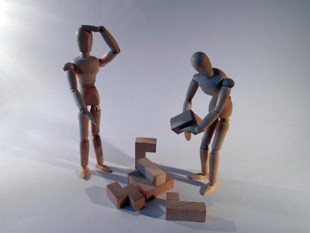 Wooden stick men using building blocks