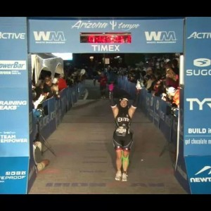 Stacy Segal crosses the Finish Line at Ironman Arizona 2014