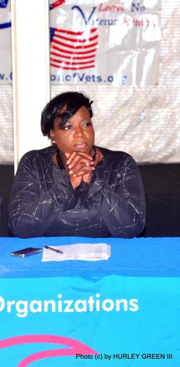 Nicole Harvey from the office of Representative Danny Davis listens attentively at the Town Hall meeting.