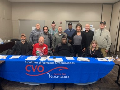 A meeting picture of the January 20th CVO meeting at Jesse Brown VA. Pictured: Seated: Michael Wallace, Larry Nazimek CVO Vice-Chair, Willie Mack CVO Chair, Ginny Narsete of Operation HerStory. Standing (L to R): Abundio Zaragoza of the Mexican American Veterans Association, Carlos Luna of Green Card Veterans, Bruce Parry CVO Treasurer, Miguel Perez, Louis Shaw, Connie Edwards CVO Director, Steve Nelson of Veterans for Peace and Russ Hopkins CVO Director.