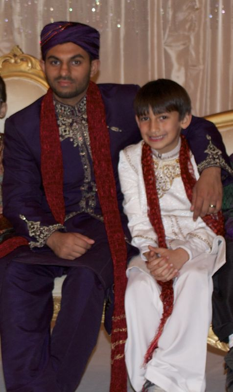My son, Laith with the bridegroom, they are best buds.