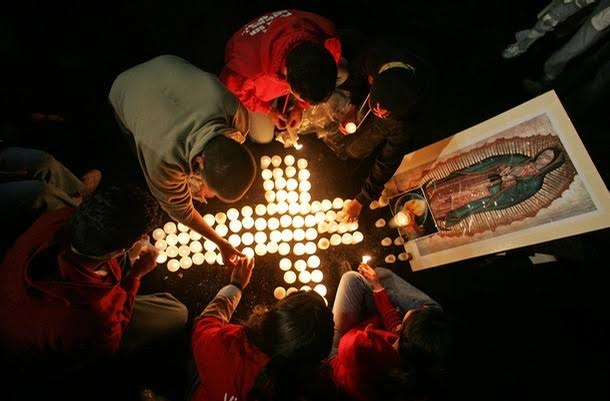 Mexican Catholic anti-abortion activists light candles during a protest against the legalization of abortion in front of the Metropolitan Cathedral in Mexico city, 23 April, 2007. Catholic organizations protested against a bill in the Local Congress that will decriminalize abortion. AFP PHOTO/Luis ACOSTA (Photo credit should read LUIS ACOSTA/AFP/Getty Images)