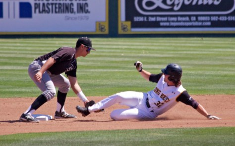 Mark Mathias applies the tag to Cameron Pongs. (Photo: Shotgun Spratling)