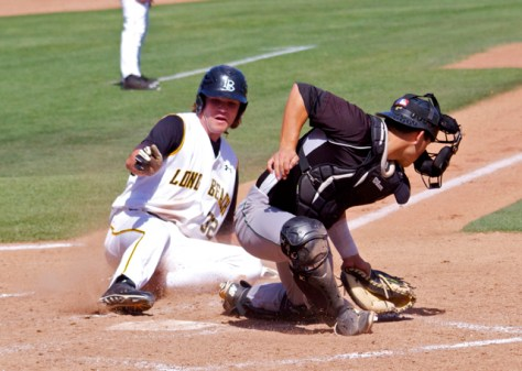 Cameron Pongs slides in before Chris Hoo's tag. (Photo: Shotgun Spratling)