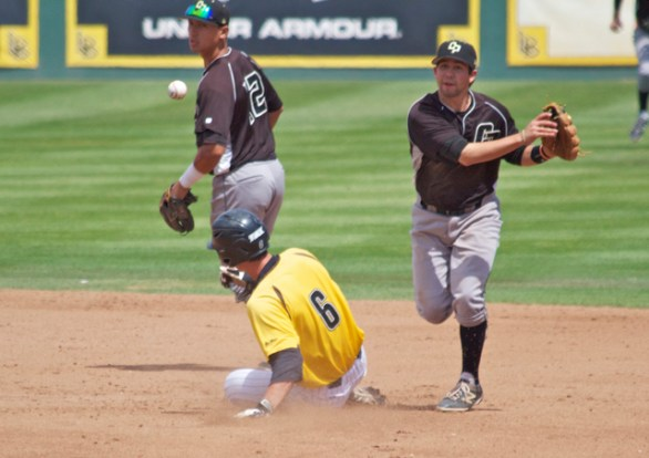 Peter Van Gansen turns the double play. (Photo: Shotgun Spratling)