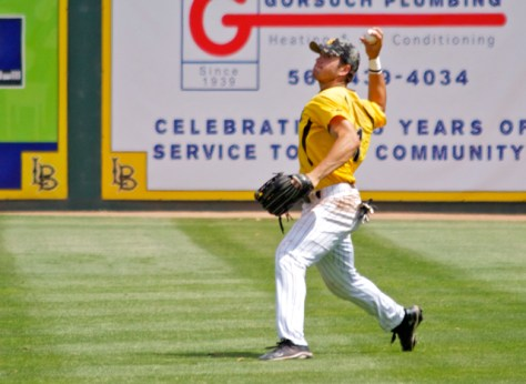 Richard Prigatano's strong throw forces a runner to hold at 3B. (Photo: Shotgun Spratling)