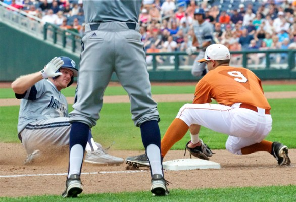 Connor Spencer is thrown out at third base. (Photo: Shotgun Spratling)