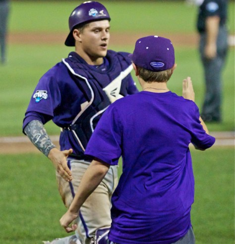 HC Jim Schlossnagle's son congratulates Kyle Bacak. (Photo: Shotgun Spratling)
