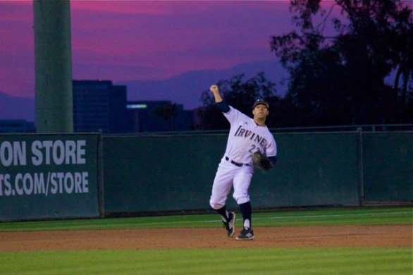 Chris Rabago fires to first beneath a purple sky. (Photo: Shotgun Spratling)