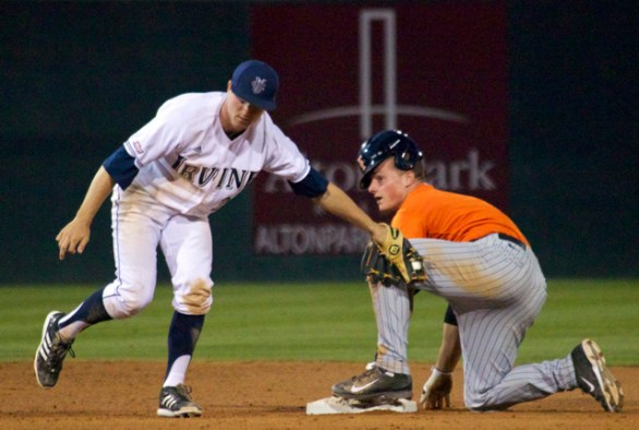John Brontsema applies the tag late on Matt Chapman. (Photo: Shotgun Spratling)