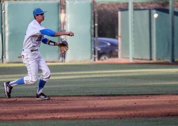 Luke Persico fires to first. (Photo: Mark Alexander)